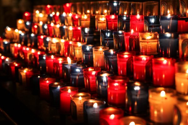 Rows of lit candles.