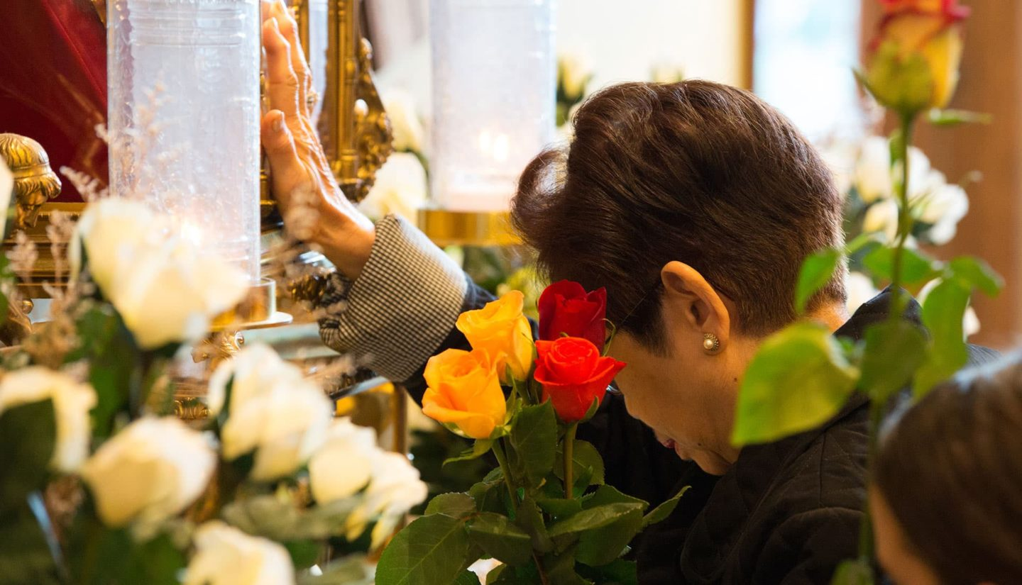 Praying at the Reliquary of St. Therese