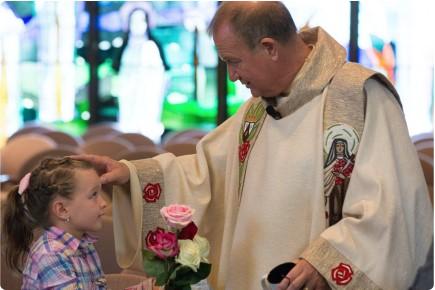 Fr. Bob and child
