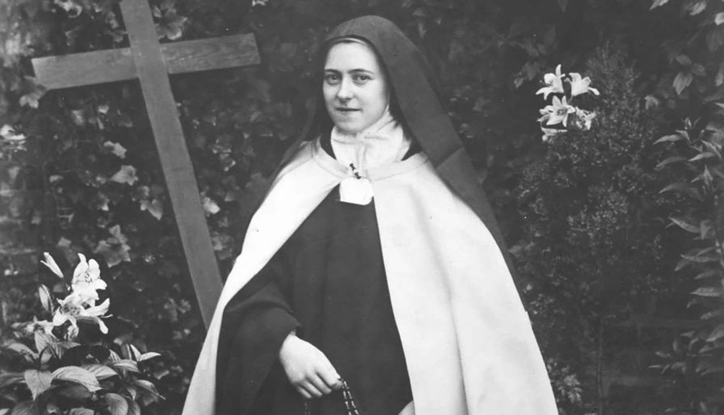 St. Therese, kneeling with rosary
