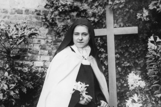 St. Therese, kneeling and holding Easter lily